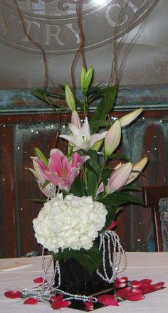 White hydrangea, star gazer and curly willow.