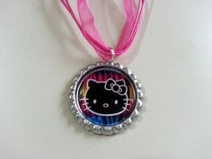 Rainbow Hello Kitty Bottle Cap Necklace by KristyJsCreations, $5.99