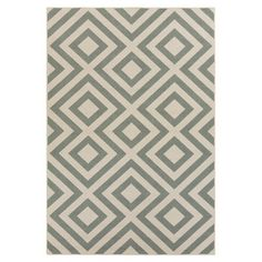 Stylishly anchor your living room or den with this eye-catching indoor/outdoor rug, showcasing an alluring geometric motif in neutral and green....
