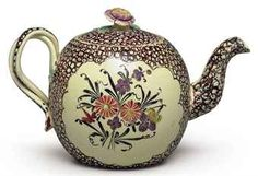 A STAFFORDSHIRE CREAMWARE CHINTZ GLOBULAR TEAPOT AND COVER SOLD $3,500 2011