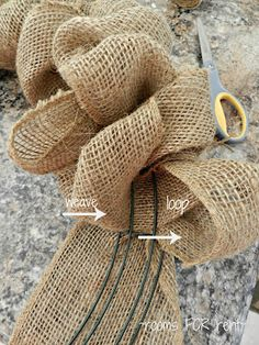 How to make a burlap wreath weaving ribbon through a wire wreath form. Be sure and follow the tutorial to TOP THIS TOP THAT for more pictures and information ~rooms FOR rent~: {Spring Burlap Wreath}