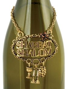 "Shabbat Shalom Wine Bottle Necklace  This Brass Wine Bottle Necklace Is A Great Way To ""Dress"" Your Bottle For Shabbat. A Kiddush Cup, Candlestick And Challah Charm Hang Below The Welcoming Words, ""Shabbat Shalom""."