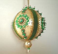 Beaded OrnamentSFH Adds: My mother used to make these beautiful balls in the late 1950's and early 1960. It was a favorite craft of women then.