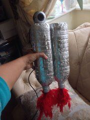 I think I'll make one of these for a spaceman costume. Cover bottles first to avoid that bad look. For Yuri's Night?