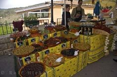 #a variety of olives at a colorful market stall in the village of Moustiers Ste Marie in Provence, France in Europe.