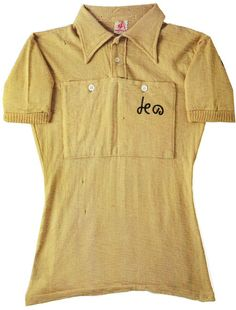 """1951 Tour de France winner Hugo Koblet's wool """"maillot jaune"""". Note the pointed collar and button front placket, a style which disappeared a few years later. Jerseys made prior to the introduction of synthetic fabrics in the late 70′s had button front pockets like the ones shown here. The Le Coq label is visible at the neckline."""