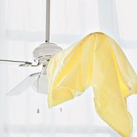 Clean a ceiling fan with a pillowcase- that way, you're not just wiping the dust off into the air.