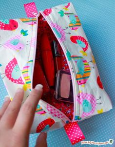 This cute little cosmetic bag has room for all your makeup. It�s fully lined, and has ribbon tabs to make zipping up easier. You�ll be surprised at how easy it is to make!.