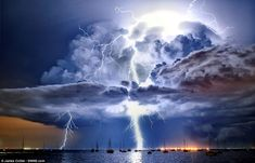 Lightning illuminates a cumulonimbus cloud over Corio Bay, Victoria, Australia by James Collier