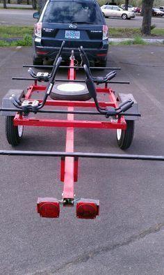 Nice trailer for two kayaks. #kayakbikertrailer #canoeupgrades #kayaktrailerdiyideas