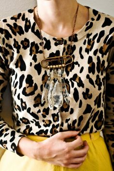 leopard cardigan tucked into yellow skirt