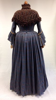 Letitia MacKenzie's blue dress with chunky knit capelet. | Costume Designer TERRY DRESBACH | Outlander on Starz