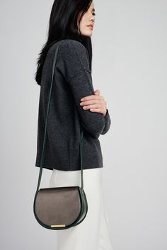 Meet the mini counterpart to spring's coveted saddle bag. Its sumptuous silhouette is crafted in Italy from the highest-quality suede, pebbled, smooth and metallic Italian leathers, and finished with polished, coated Italian gold hardware that lends the ideal elegant finish. The compact silhouette is roomy enough for your iPhone and other essentials, while the adjustable crossbody strap allows for versatile carrying options. This gorgeous piece will complement your everyday with an air of…