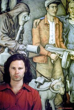 Jim Morrison on his visit to Mexico next to a mural by Diego Rivera