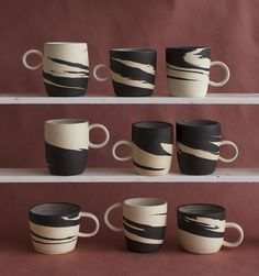Marbled black clay mugs by Helen Levi
