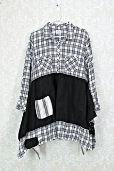 Beautiful Black Grey and White Upcycled Tunic that is very Flattering. Two patch pockets on Bodice and I added two to the skirt section. There is a light gold strip in the Flannel Print on the Bodice which I complimented using gold thread to secure the se