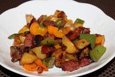 Kielbasa skillet with onion, potatoes, and peppers. Delicious one pan meal.