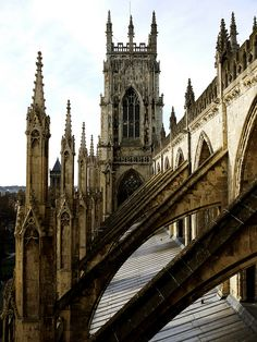Flying Buttresses. They look lovely, but actually play a large role in keeping the structure steady.