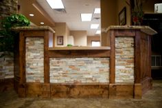 It doesn't get any more natural than this. By framing stone with knotty alder, the reception desk is the focal point of this space!