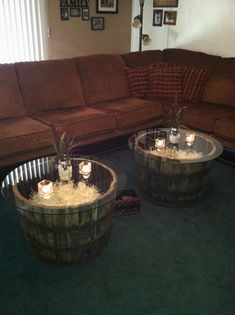 """Jack Daniel's Whiskey barrel coffee tables - Barrels can be found at Osh.  32"""" round glass can be cut from a local glass shop (you can get fancy with beveled edges, etc)  They are filled with basket filler that can be found at Michael's (put some scrunched up newspaper in the bottom in order to use less filler - then add your own personal decor on top.  They are one of the more pricier crafts - but you will absolutely love them."""