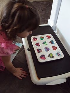 make new crayons on a elec. skillet. good idea for all those broken crayons I cleaned out of the closet at work!!