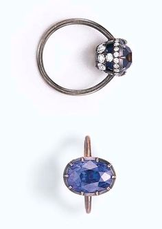 A SAPPHIRE AND DIAMOND RING, BY JAR  Set with an oval-cut sapphire, weighing approximately 8.59 carats, within a diamond openwork gallery, mounted in 18k oxidized gold, with French assay mark and maker's mark, in a JAR pink leather fitted case Signed JAR, Paris