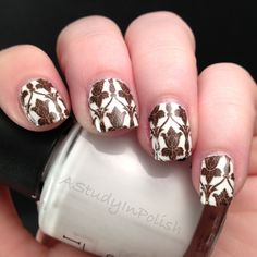 Sherlock wall paper nails - This. Is. AMAZING. I wish I had the skills to pull this off. Why don't they make those polish strips with this pattern? I would totally buy those, and they're pretty, so non-sherlockians would buy them too...