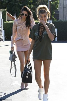 Here they come! The photogenic models looked relaxed as they bonded over a spot of shoppin...