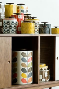 Orla Kiely Kitchenware - - Orla Kiely 1 Litre Linear Stem Yellow Storage Jar inclusive delivery The perfect size for tea bags, coffee, rice and pulses, these gorgeous ceramic jars have dark wood lids with a rubber seal…. Jar Storage, Kitchen Storage, Storage Canisters, Yellow Storage, Wooden Counter, Concrete Counter, Vintage Kitchenware, Orla Kiely, Retro Home