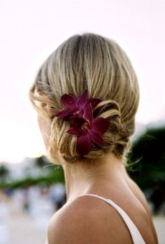Similar to my wedding day style but a bit looser and decorated with similar flowers in my bouquet. Thanks to my sister who's my hair stylist. :-)