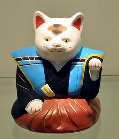 Fushimi-Tonpuppe 1 makffm - Maneki-neko - Wikipedia, the free encyclopedia Neko Cat, Maneki Neko, Japanese Mask, Clumping Cat Litter, Beautiful Dark Art, Owning A Cat, Cat Behavior, Clay Dolls, Cat Art