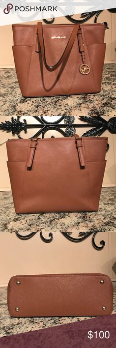 **PRICE DROP*** Michael Kors Tote Purse Gently used clean Michael Kors tote shoulder purse. No scratches rips or holes. Great condition! Michael Kors Bags Shoulder Bags