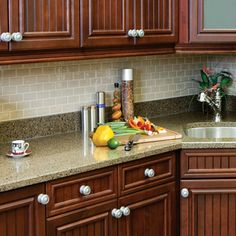 """Peel and stick """"glass"""" tiles, no grouting, cuts with snips, no tile cutting needed, water and mold resistant (saw this on diy network last night) Available at Home Depot!"""