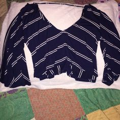 Olivaceous boho crop top Navy with stripes. Second photo of model wearing it is in a different color that I do not have, however that is the same top to display the fit. Worn once, great condition! Olivaceous Tops Blouses