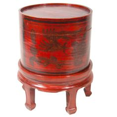 """Chinese hat box on stand from the late 19th century. Antique lacquered & chinoiserie decorated hat box made of laminated parchment on new stand. Interior is gold lacquer. Exterior is red gold design. Condition is good. CIRCA: Late 1900's DIMENSIONS: 20"""" h x 16"""" d PRICE: $1,200"""
