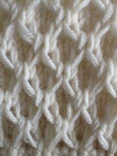 Being Ruth Cross- notes from a hand knit studio....Instructions for a similar pattern here; http://www.knitaholics.com/2012/11/05/how-to-knit-slip-stitch-pattern-slippy-mesh/