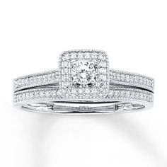A round diamond framed in additional diamonds forms the irresistible centerpiece of her engagement ring in this captivating bridal set. The 14K white gold band and matching wedding band feature more round diamonds, edged in delicate milgrain detail to complement. The bridal set has a total diamond weight of 1/3 carat. From the Now & Forever® Bridal Collection. Diamond Total Carat Weight may range from .29 - .36 carats.