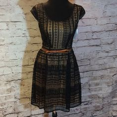 BEAUTIFUL DRESS BY CITY TRIANGLES This is so pretty with a tan slip lining underneath that shows through the black lace overlay. It has a beautiful detailed cutout on the back and side zip with a contrasting brown bow belt City Triangles Dresses Mini