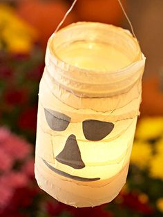 Haunting Ghost Lantern, made these but used orange tissue paper and painted the top green.  Very cute!