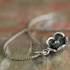 whimsical sterling silver patinated flower