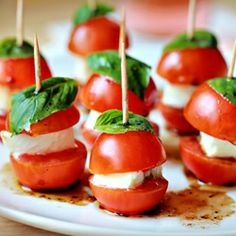 Mini Caprese Bites: delicious and adorable. Was a cute appetizer. I didn't cut the cherry tomatoes in half and it still all stayed on the toothpick just fine. -H