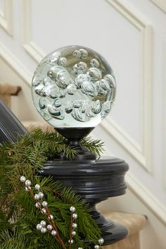 Martin Horner spotted this seeded glass ball in a Portland, Oregon, shop. He carted it home in his suitcase, and repurposed it as a dazzling accent on the antique newel post at the bottom of the front hall stair. Chicago Christmas, Green Christmas, Christmas Colors, Christmas Home, Christmas Decorations, Natural Christmas, Magical Christmas, Elegant Christmas, Classic Architecture