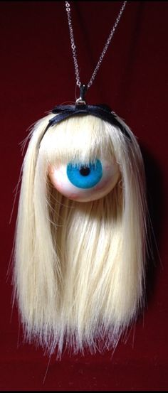 Apparently you can give someone the hairy eyeball either figuratively… or literally. Piskel Art, Ball Hairstyles, Weird Jewelry, Gothic Jewelry, Creepy Dolls, Doll Parts, Assemblage Art, Creepy Cute, Doll Head