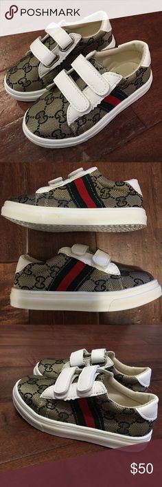 Kids GUCCI logo sneakers A totally fabulous pair of children's GUCCI STYLE all over GG pattern logo sneakers. Red and green stripes down the side. White faux leather trim. Double Velcro closure. Perfect for any little fashionista!! Size 11 Brand new. Shoes Sneakers