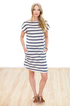 Dress Baloux  Everybody loves a classic striped knit dress for summer. Its classic boat neck and elasticized waist give it its feminine silhouette. Made of a comfortable knit fabric in beige and blue it is perfect for summer days.We suggest decorating its neckline with a chunky necklace for a subtle touch of glam.