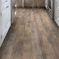Wood Laminate Flooring. Glue together thin slices of wood. The glue helps to add strength to the wood.