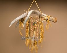This is an authentic Native American choker breast plate made by the Laguna Pueblo Indians displayed on a genuine antler for wall decor. A beautiful American Indian breast plate, this is made complete