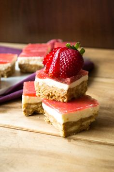 A strawberry slice with a biscuit base, cheesecake filling and fresh strawberry jelly topping.