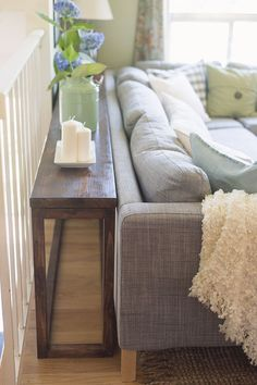 DIY sofa tables are easy and can add a lot to an open room design. This post offers up different ways you can design a sofa table to add space to a room. Diy Sofa Table, Sofa Tables, Narrow Sofa Table, Farmhouse Sofa Table, Dyi End Tables, White Sofa Table, Narrow Coffee Table, Long Sofa Table, Sofa Table With Storage