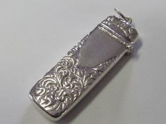 This is just a fantastic needle case! The borders have an ornate respousse design of paisley like scrolls, surrounding a central area which could be engraved. The top hinges open to hold a selection of needles or other small treasures. | eBay!